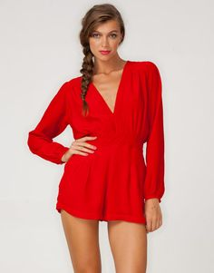 4c25b272bf Long Sleeve colour block Motel playsuit in red with super low plunge v  neckline and clinched
