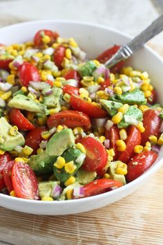 Summer in a salad - fresh avocados, cherry tomatoes & sweet corn, mixed with red onions and lime juice. Perfect for a summer picnic or potluck!