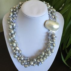 """HPNWOT Blue Reborn Keshi & Grey Pearl Necklace HOST PICK 6/12 for the Pretty, Flirty & Girly Party!   NWOT 19"""" Necklace 5 Strand Natural Freshwater Cultured Blue Reborn Keshi Pearl & Grey Round & Rice Pearl & Faceted Grey Rhombus Crystal.  Good Quality. High luster pearls with a White Shell Clasp. 6-7mm (smaller pearl) 9-12mm (bigger pearl). No Trades & No PayPal Jewelry Necklaces"""