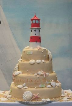 Lighthouse Wedding Cake Lighthouse Wedding Cake Everything is made from fondant. The seashells are modeled with push-molds and some are dusted with luster dust.... #featured-cakes #leannew #cakecentral