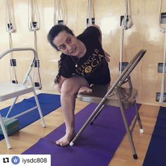 Advanced Certified #iyengaryoga Teacher, Lois Steinberg teaching #utthitaparsvakonasana, #extendedsideanglepose with a chair.