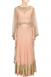 Pink embroidered asymmetric cape blouse with gold border lehenga