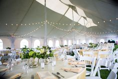 Adi & Spencer - Black Butte Ranch. The reception tent, the buttery yellows, crisp greens and vibrant blues were perfect. Photo by Powers Studios.
