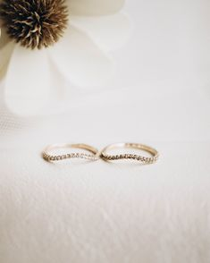 A thin and delicate diamond arched band made to curve perfectly around a low setting or fancy shaped engagement ring. For a slightly thicker band, check out the Thick Diamond Chase Band.