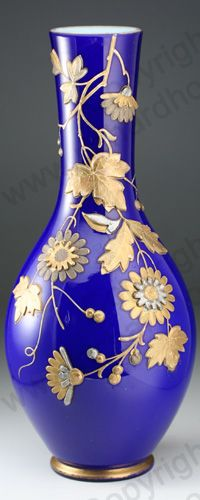 ANTIQUE GLASS IN BLUE. c.1890 HARRACH BLUE OVERLAY VASE WITH HIGH RELIEF DECORATION