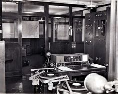 Shortwave station W8XWJ Detroit  7-7-1940.  Equipment shown (left to right):  RCA turntables in foreground; Western Electric audio console; Western Electric 500 Watt Ultra-Shortwave transmitter.