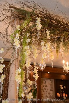 Hanging orchid strands for garden themed wedding decor by Village Vines Floral and Event Decor www.villagevinesflorists.com #gardenwedding #custommade #orchidwedding