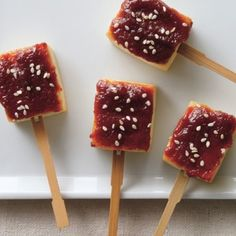 A sweet-and-salty miso glaze turns tofu          into little bites of comfort food, traditionally served on skewers.