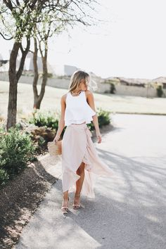 Pink maxi skirt + white crop top + straw clutch   spring style