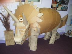 Dinosaur Party : Huge cardboard dino prop : Would be fun to make and paint! : Lewis the lion with a dinosaur at Summerbank Primary School