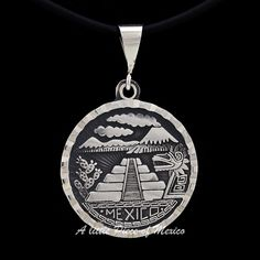 """This beautiful silver pendant displays characteristic elements of the ancient cultures that developed in Mexico before the arrival of the Spaniards.    Depicted are the volcano named Popocatepetl and its neighbouring mountain the Iztaccihuatl on top of the pendant, its typical cactus or """"nopales"""" on the right of the magnificent Chichen Itza pyramid and the representation of Kukulcan, the """"feathered Serpent God"""", to the left, and underlined by the name of the place where all this resides…"""