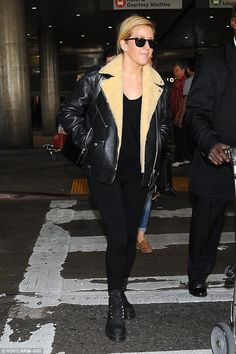 Back in black: Ellie Goulding, 28, channelled her inner rockstar as she covered up in a stylish moto leather jacket at LAX airport on Saturday