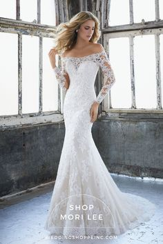 The Mori Lee Karlee style is a gorgeous lace wedding dress!  This wedding dress with sleeves will leave you feeling elegant and sophisticated.