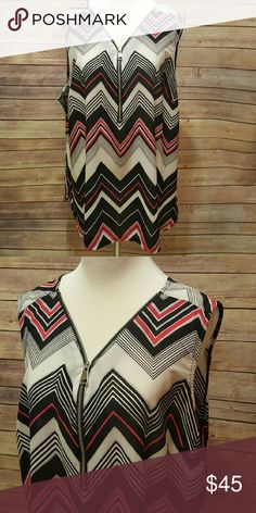 Plus size blouse Sleeveless. Half zip up front. Pink, black, and creamy white chevron print. This top is still in stores.  Bought to wear to poshfest.  Never worn. Size 22/24. Avenue Tops