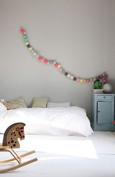 Love these pops of colour with the grey. A great DIY pom pom garland, for a kids room? Nah, for MY room!