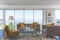 Mid-century inspired, the Lorelai sofa brings together grey and yellow in a nostalgic combination with breathtaking views of Laguna Beach. Visit our home inspiration page and see more living rooms. #LivingSpaces