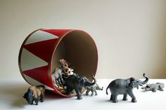 Paint a hat box to look like a drum - cute idea for circus room!