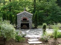 The perfect outdoor fireplace complete with pizza oven for my dreamscape