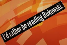 A must for all Charles Bukowski fans! This is a bumper sticker, white text on black background, which reads:  Id rather be reading Bukowski.  It is vinyl, and can survive all kinds of weather while stuck to your car, bike, or wherever you decide to put it.  It measures 1.5 x 8.5 and has white text on a black background.  Note that the last two photos are only to show the size of the item against a US ruler, and do not reflect the design on the sticker(s) you are ordering. *Please read shop…