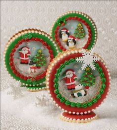 SNOW GLOBE COOKIES!! :))  A flurry of snowflake confetti, sanding sugar, and nonpareils adds sparkle to these  fun yuletide favors. You can make your own Royal Icing figures for the central vignettes or, to avoid the holiday rush, use readymade decorations as pictured.