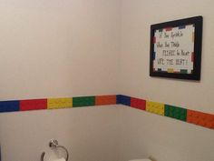 Love the new lego bathroom...cut wood and circles to make lego border. Found lego stickers at JoAnns to border the sign. Just used stickers to write out sign. Large frame completed that look.