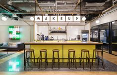 The Hong Kong-based architect Nelson Chow has collaborated with the in-house design team of international co-working enterprise WeWork, to outfit its new Causeway Bay location. Inspired by the city's iconic trams, ferries and trains, the office space f. Cafe Interior, Office Interior Design, Office Interiors, Workspace Design, Office Workspace, Cool Office Space, Small Office, Office Decor, Commercial Design