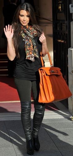 Who made Kim Kardashian's jeans, orange purse and black thigh high boots that she wore on September 17, 2010? Purse – Hermes  Jeans – Citizens of Humanity  Shoes – Lanvin