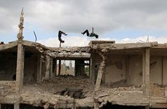 Parkour coach Ibrahim al-Kadiri (R), 19, and Muhannad al-Kadiri, 18, demonstrate their Parkour skills amid damaged buildings in the rebel-held city of Inkhil, west of Deraa, Syria, April 7, 2017. Ibrahim discovered Parkour in Jordan, where he had fled to escape the war. Back in his home town since 2015, he now leads a group of 15 practitioners. REUTERS/Alaa Al-Faqir #MiddleEast #Parkour