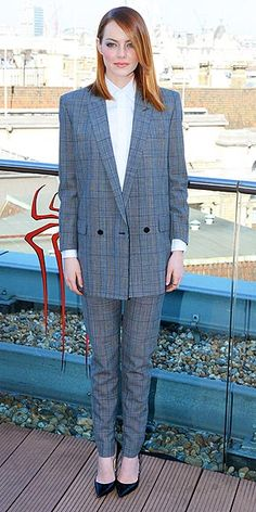 EMMA STONE Has Emma gone mad for plaid? The flame-haired actress wears a gray checked suit when she poses for the cameras at a photo call for The Amazing Spider-Man 2 in London.