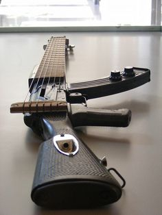 "AK-47 guitar , try bringing that on a plane ""no really it's a guitar !"""