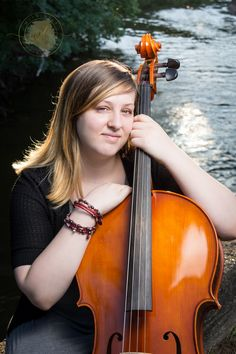 High school senior portrait taken with her cello on the riverside by Lily Angiolini of Miss Lily Photography in central Michigan, summer 2018