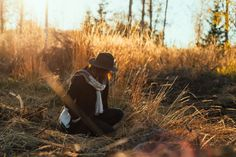 female sitting in high grass during in the late October sun © Rania Maria Photography