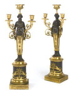 A pair of Directoire ormolu and patinated bronze two-light candelabra circa 1795