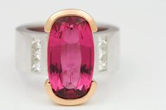 RADIANT INTENSE PINK RUBELLITE RING: Solid 18 carat white and rose gold ring featuring a 9.12 carat Rubellite Tourmaline and six G-VVS princ...