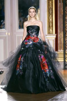 Black satin with tulle and shocks of vibrant red flowers. Zuhair Murad