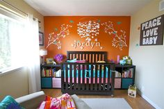 Orange accent wall - such a fun pop of color! #nursery