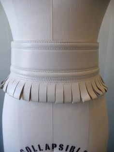 There is nothing like a belt to play up your figure. And there is no belt like an Alaia belt. From stylish stars like the Olsen twins, to o. Fur Fashion, Daily Fashion, Hermes Belt, Designer Belts, White Belt, Alaia, Belts For Women, Leather Craft, Cheer Skirts