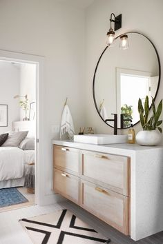 modern bathroom, clean bathroom, simple bathroom design, master bathroom, round mirror in bathroom, large bathroom mirror #bathroom #masterbathroom #BathroomToilets