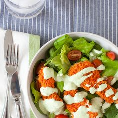 Buffalo Chicken Salad with Creamy Avocado Ranch Dressing Recipe Salads with panko, olive oil, all-purpose flour, garlic powder, kosher salt, large egg whites, water, dijon mustard, dried thyme, cooking spray, boneless skinless chicken breasts, buffalo sauce, avocado, mayonnaise, sour cream, olive oil, lemon juice, chives, fresh parsley, garlic, buttermilk, freshly ground pepper, salad greens, grape tomatoes, crumbled blue cheese, scallions, bacon, shredded cheddar cheese, purple onion