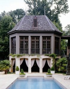 2 story Cabana off side of the home through a walkway of main home - have a staircase that allows access to the pool from the 2nd floor. Have the 2nd floor be more like a sitting /chill' axing room