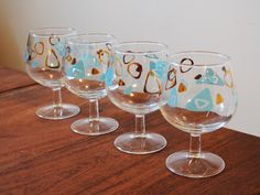 Set of 4 Vintage Federal Glass Amoeba Barware, Cognac or Sniffer glasses, 'Boomerang', Turquoise and Gold circa 1950s by Trashtiques on Etsy https://www.etsy.com/ca/listing/497790028/set-of-4-vintage-federal-glass-amoeba