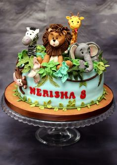 An incredible fondant animal themed cake! Jungle Safari Cake, Jungle Birthday Cakes, Jungle Theme Cakes, Boys 1st Birthday Cake, Animal Birthday Cakes, Safari Cakes, Animal Cakes, Themed Birthday Cakes, Themed Cakes