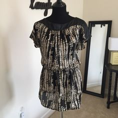 Fun silky Top! 100% polyester! Looks great with tights and a belt! Tops Blouses