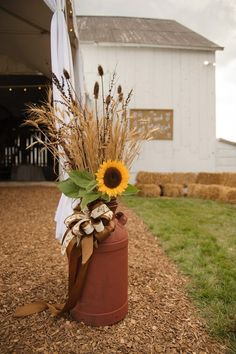 I love the look we created with these milkcans (scored at a local auction for $11 each!), wheat, teasel and tobacco weeds from the fields around Broad View Farm, and sunflowers from the garden. Perfect for a September Barn Wedding!