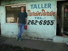John in front of Duran Duran building Still In Love, Just Love, Love Him, Nigel John Taylor, Roger Taylor, Save My Life, Love Of My Life, Great Bands, Cool Bands