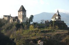 Castle ruin Petersberg (Peter´s mountain) with the 28 m high keep (sheltering the city museum) and Peter´s church in the medieval city of Friesach, Carinthia, Austria
