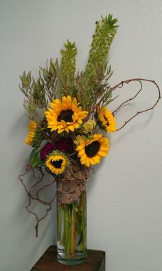 photo ... flower arrangement ... orange and green ... sunflowers ...