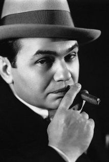 Edward G. Robinson was born Emmanuel Goldenberg in Bucharest, Romania. He arrived in the United States at age ten, and his family moved into New York's Lower East Side. He took up acting while attending City College, abandoning plans to become a rabbi or lawyer. Although best known for playing fierce, shady little men, Robinson was well liked by almost everyone off-screen, having been a sensitive, quiet, artistic type when not performing.