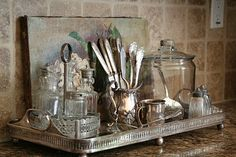 vintage silver, glassware and silver tray. I love tarnished vintage silver trays to anchor anything from a coffee table, to on top of a dresser or in a washroom.