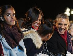 Joking around: The scene was a change in tone from Malia and Sasha's somber attitude on Th...